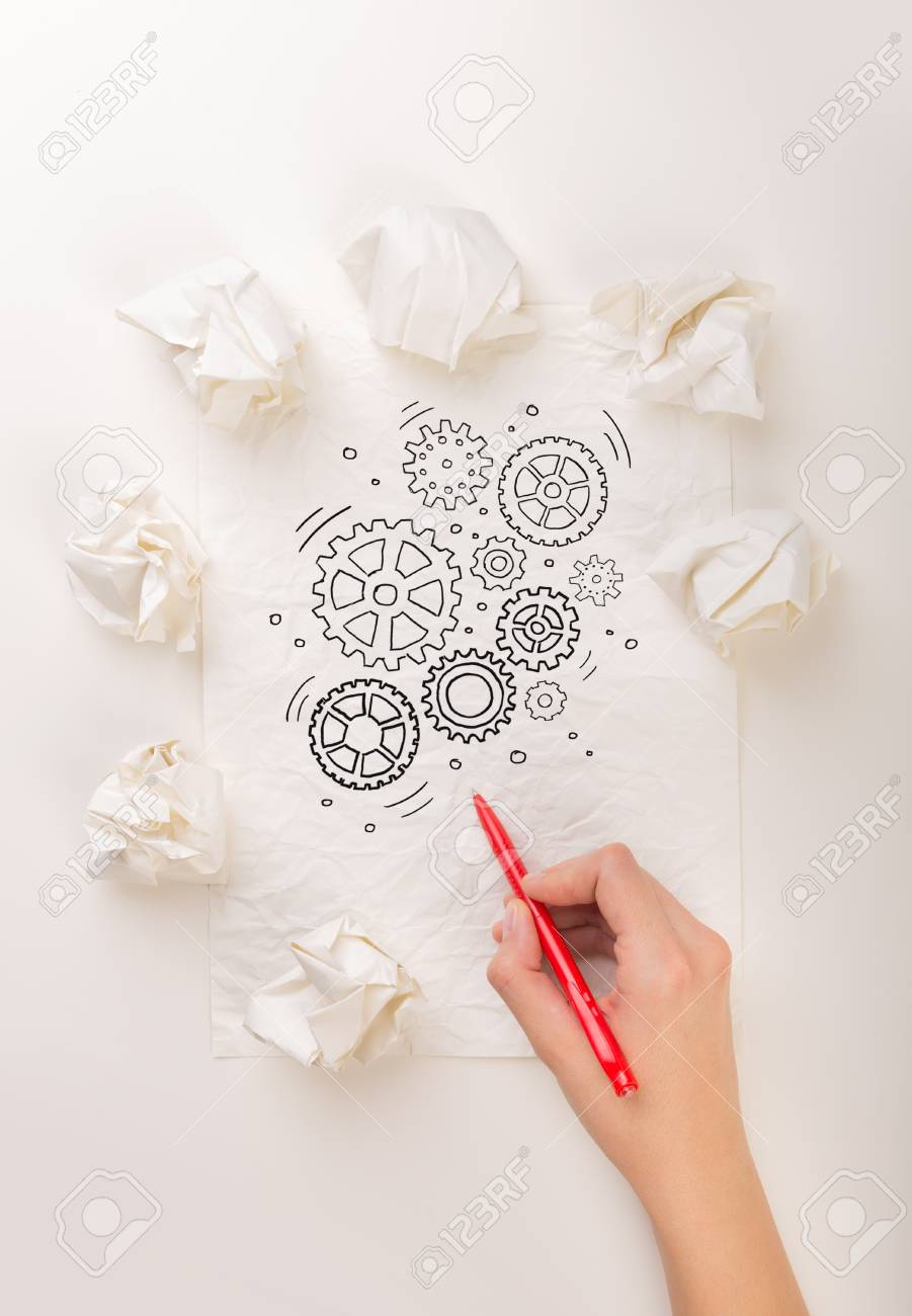 female hand next to a few crumpled paper balls drawing rotating