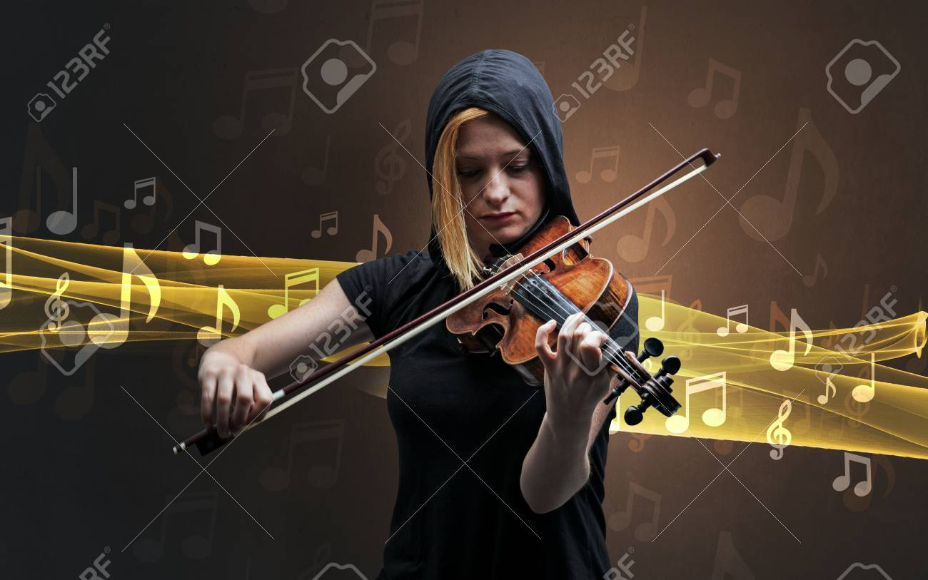 Young male musician playing on his violin with musical notes around - 91535131