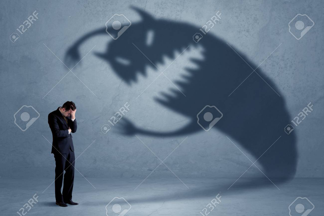 Business man afraid of his own shadow monster concept on grungy background - 95989955