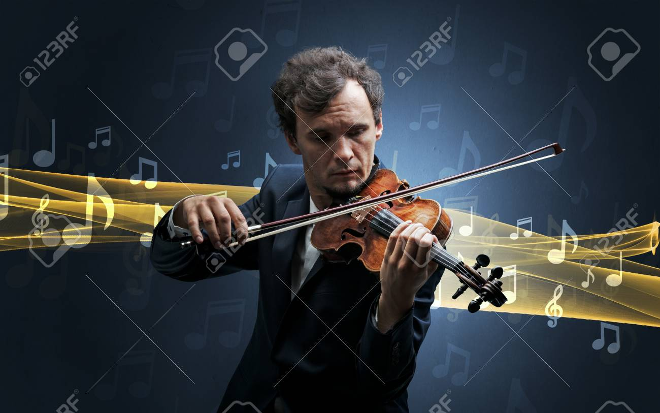 Young male musician playing on his violin with musical notes around - 97852088
