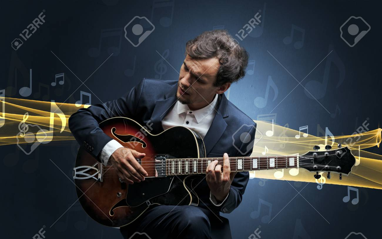 Musician playing on guitar with notes around - 99464333