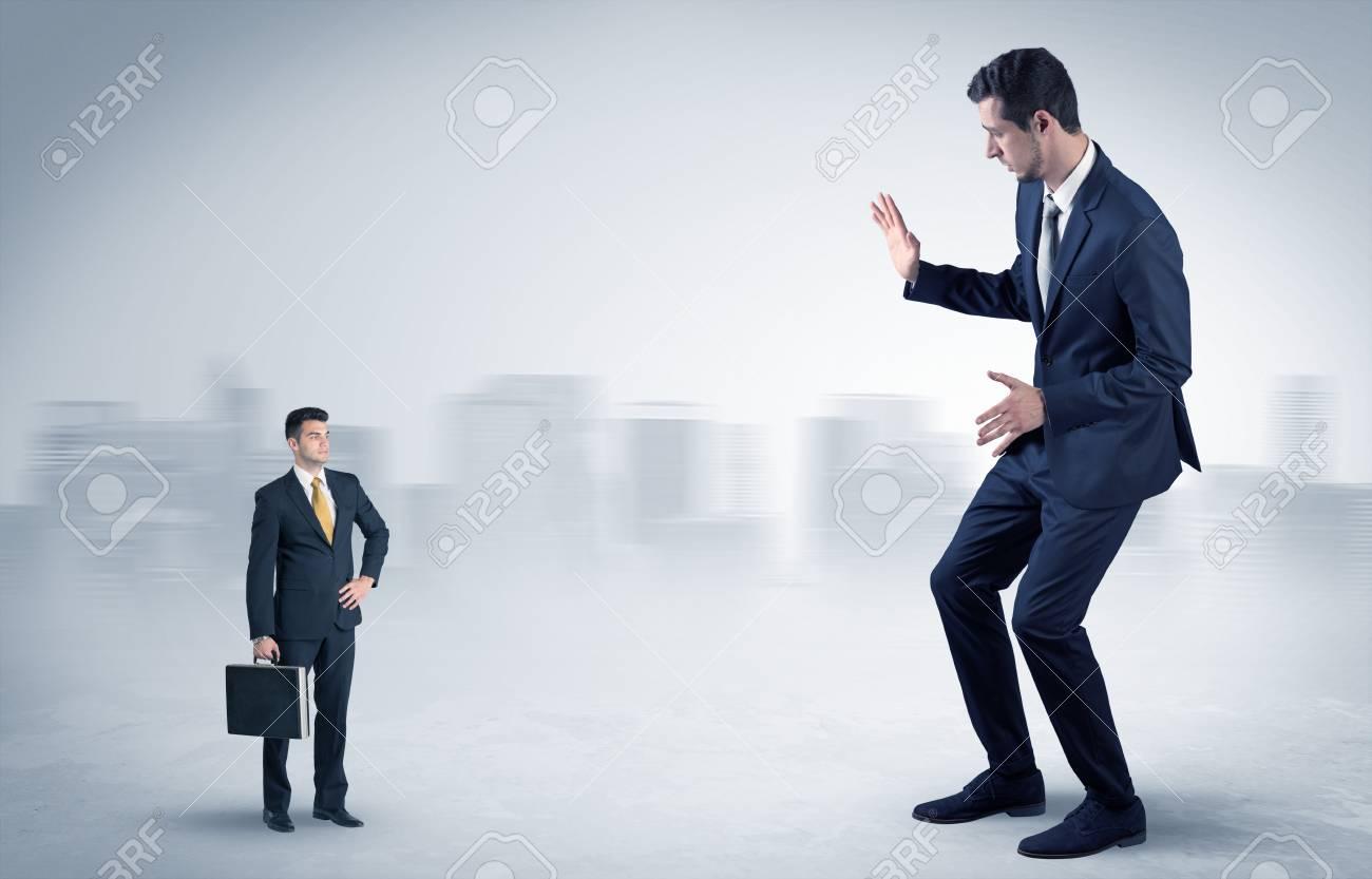 Giant businessman is afraid of small executor - 100766587