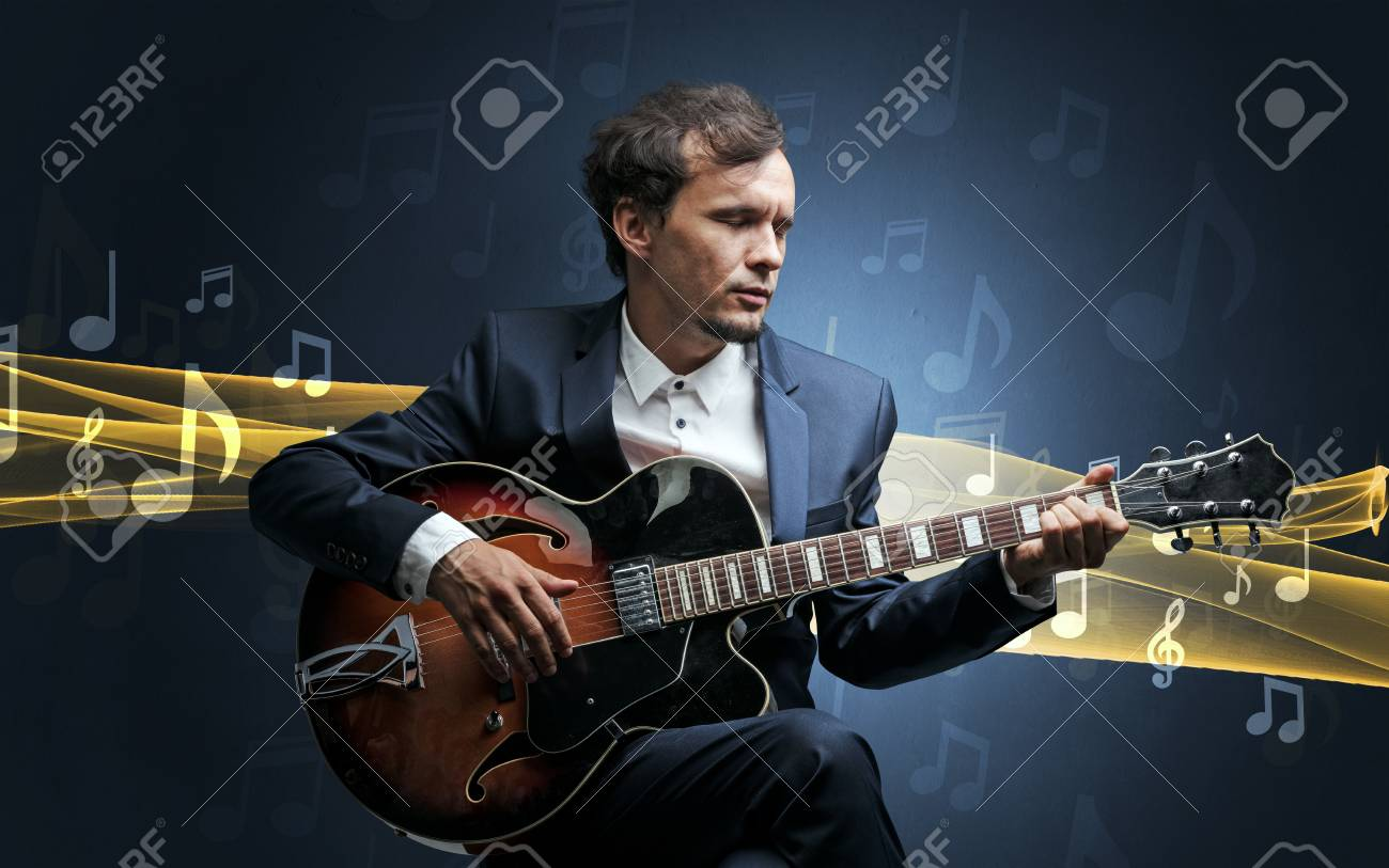 Musician playing on guitar with notes around - 111142353
