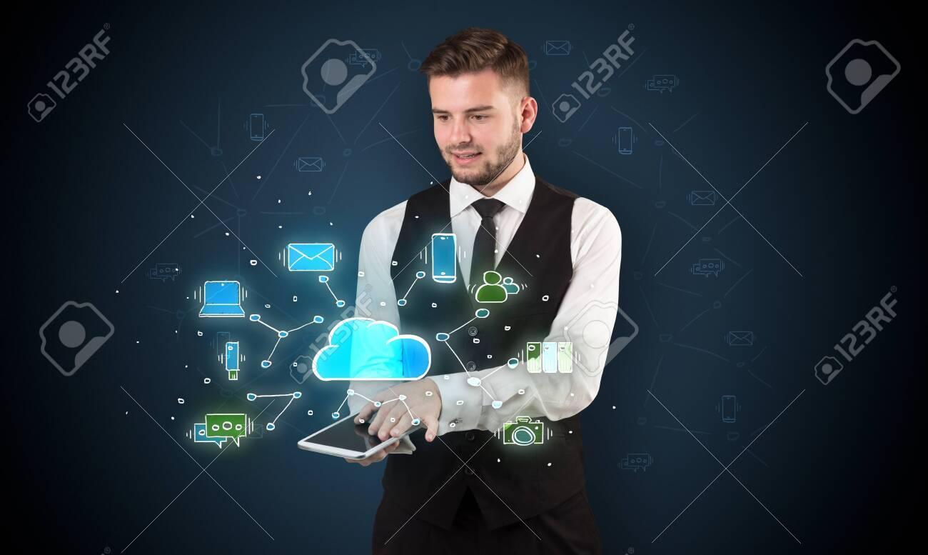 Chalk drawn cloud technology symbols on a tabled handled by businessman - 121099807