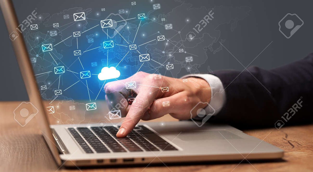 Businessman hand sending a bunch of messages on laptop with cloud computing concept - 122932638