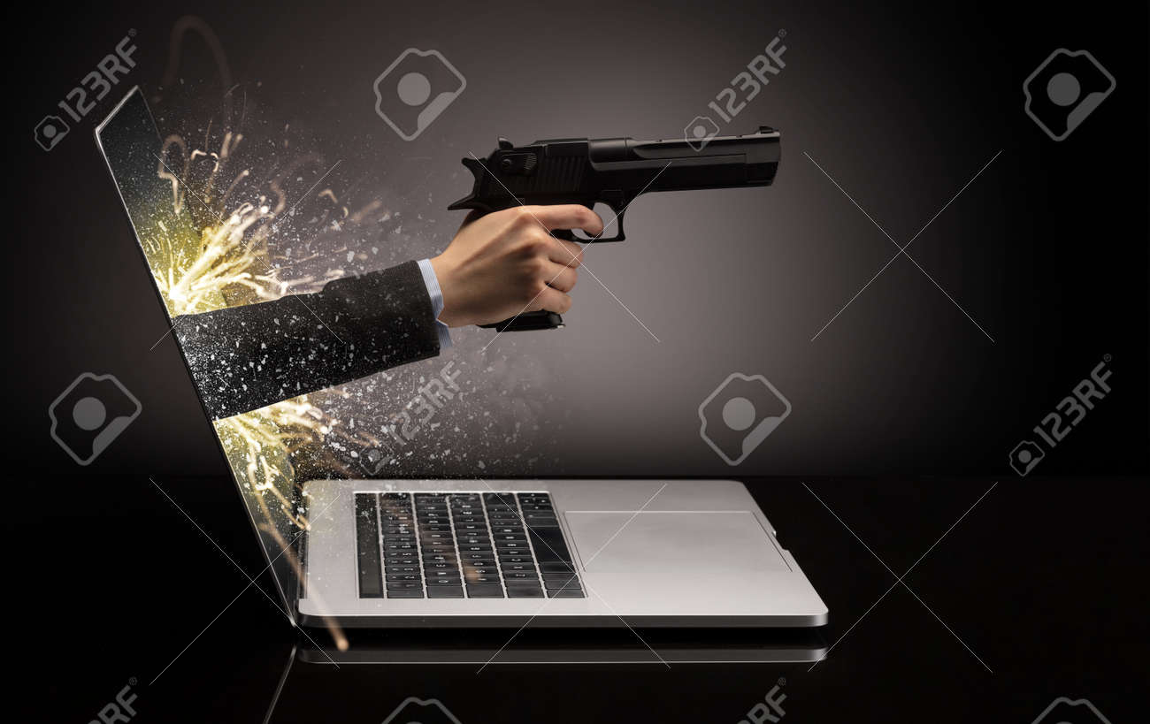 Hand with gun coming out of a laptop with sparkling effects - 125966277