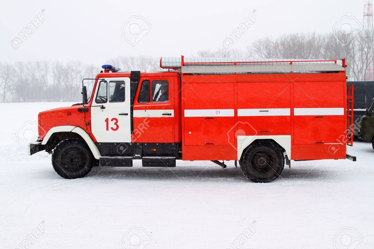 Fire truck in the winter. Is heavy snow Stock Photo - 9866357