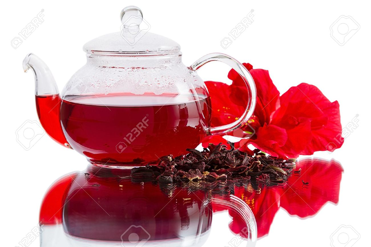 Hibiscus flower dry tea and brewed tea in a teapot isolated hibiscus flower dry tea and brewed tea in a teapot isolated on a izmirmasajfo Images