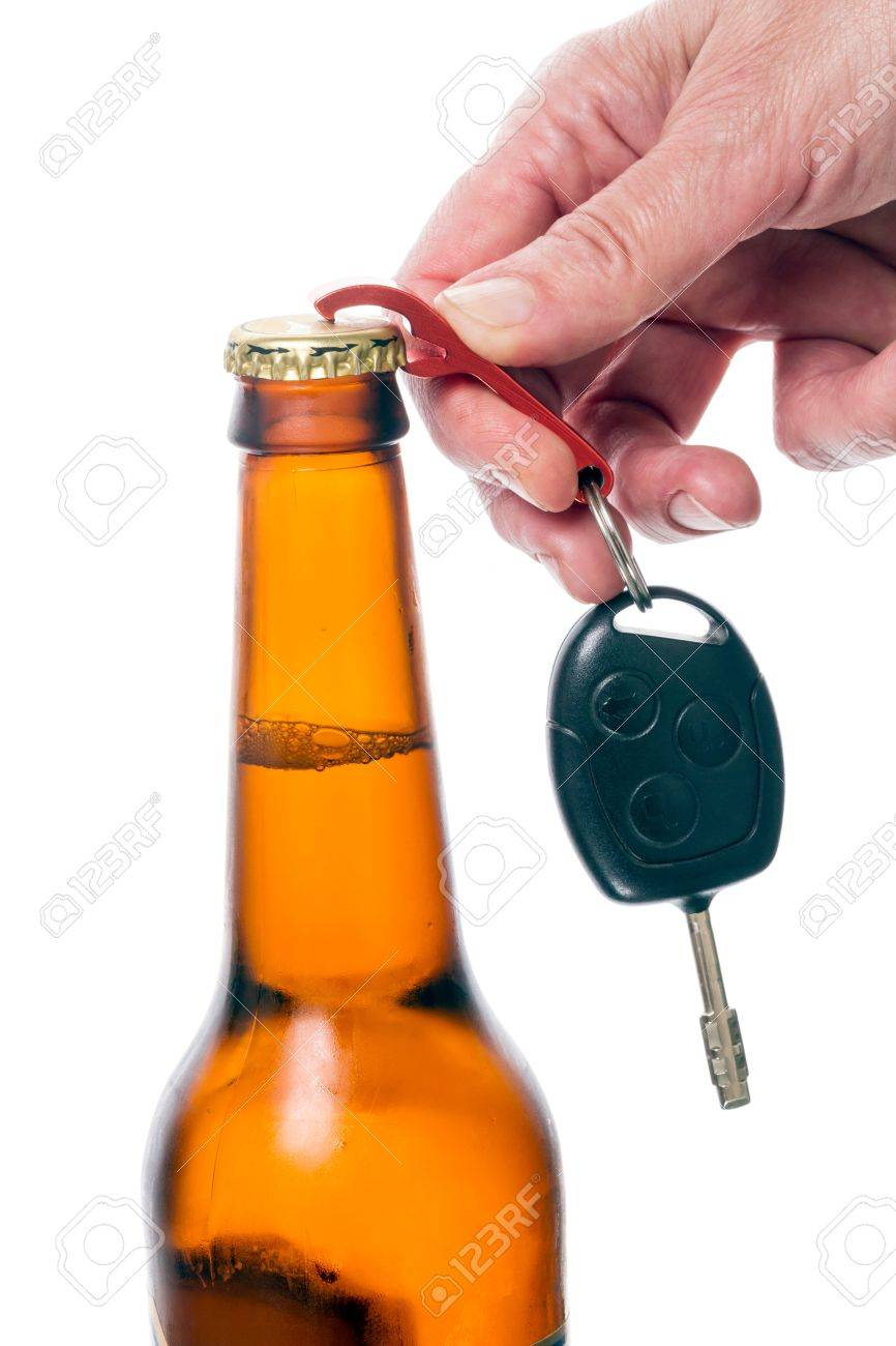 Hand opens a bottle of beer keychain car key. Isolated on white background Stock Photo - 21436655