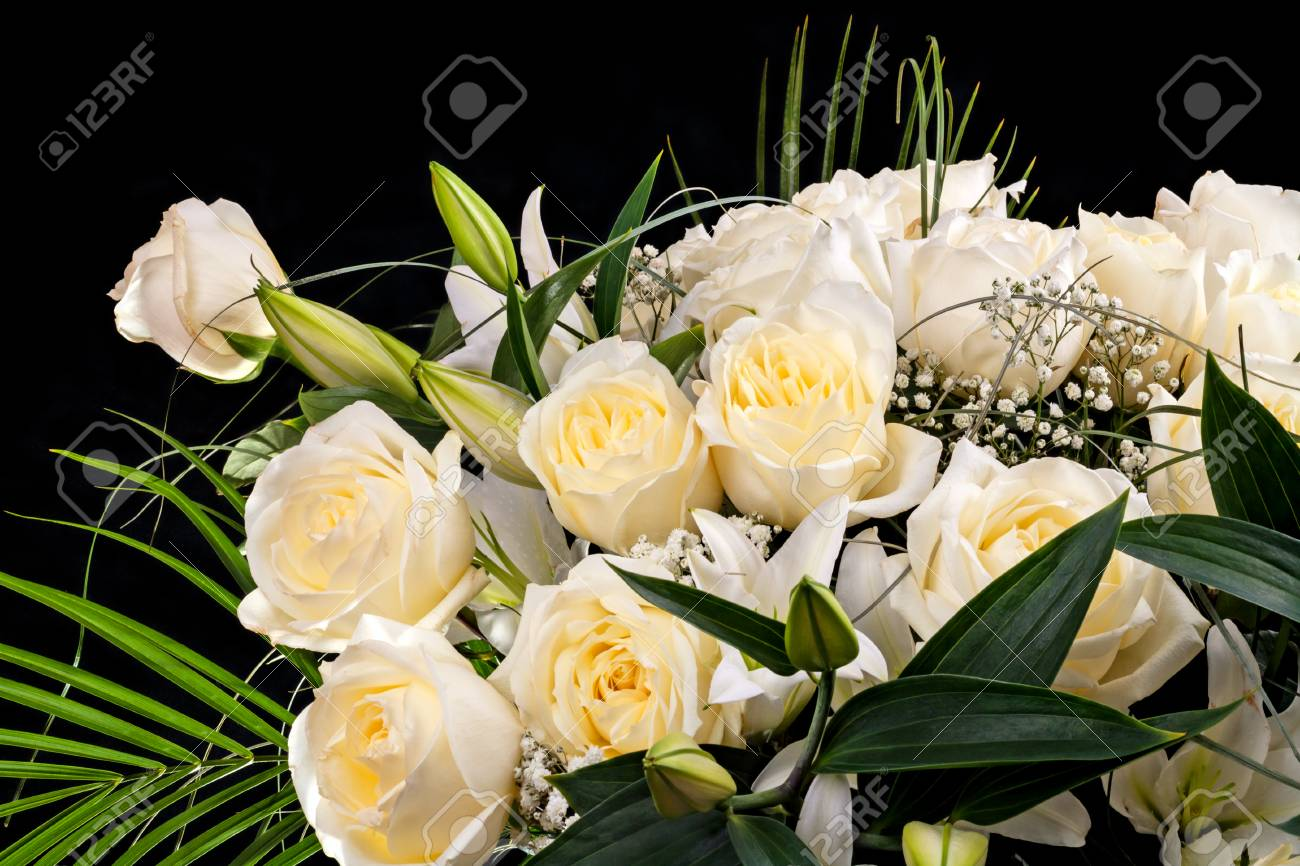 Bouquet Of White Flowers Roses Lilies On Black Background Stock