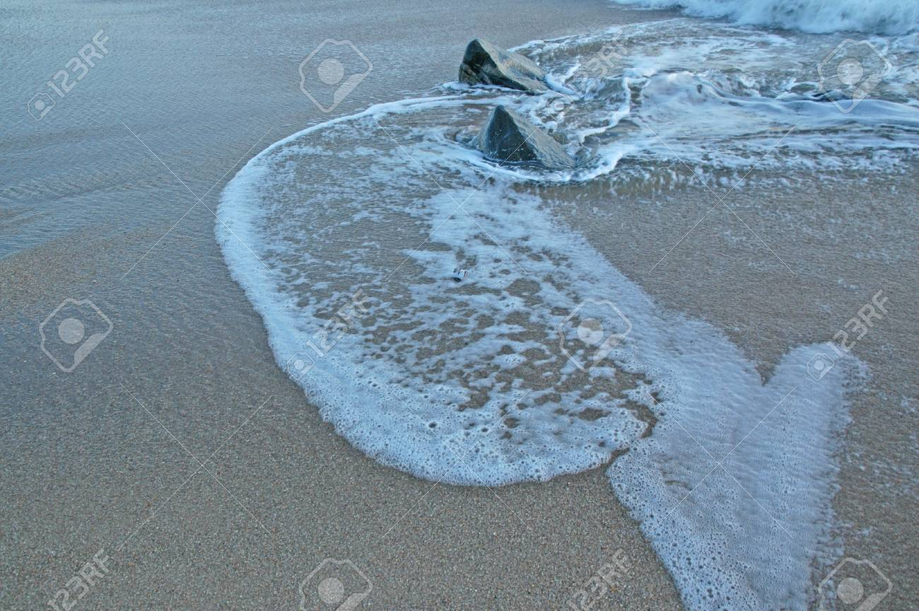 Footprints going over a sand dune Stock Photo - 17075223