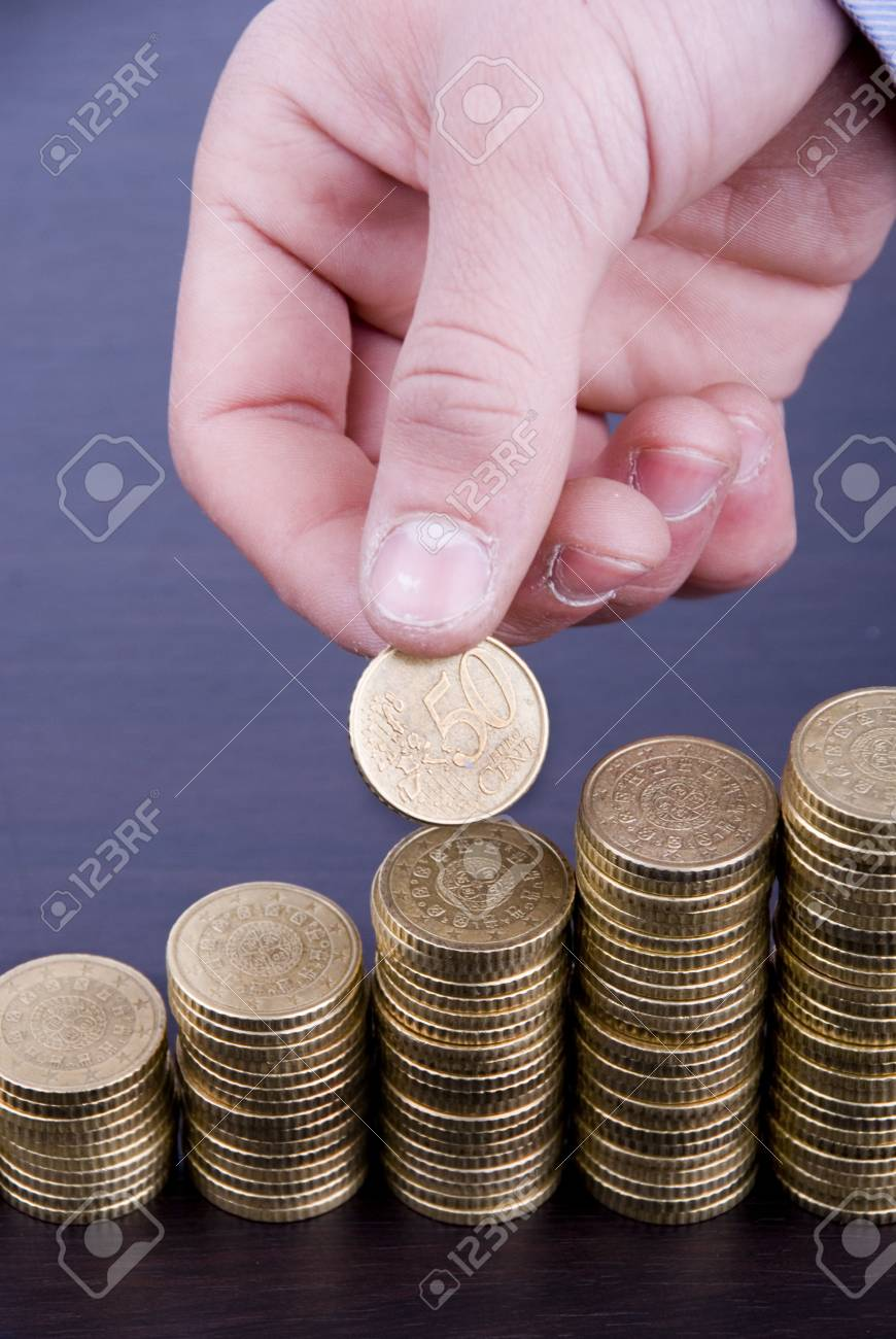 Increase your savings-Hand holding coins against white background Stock Photo - 17075740