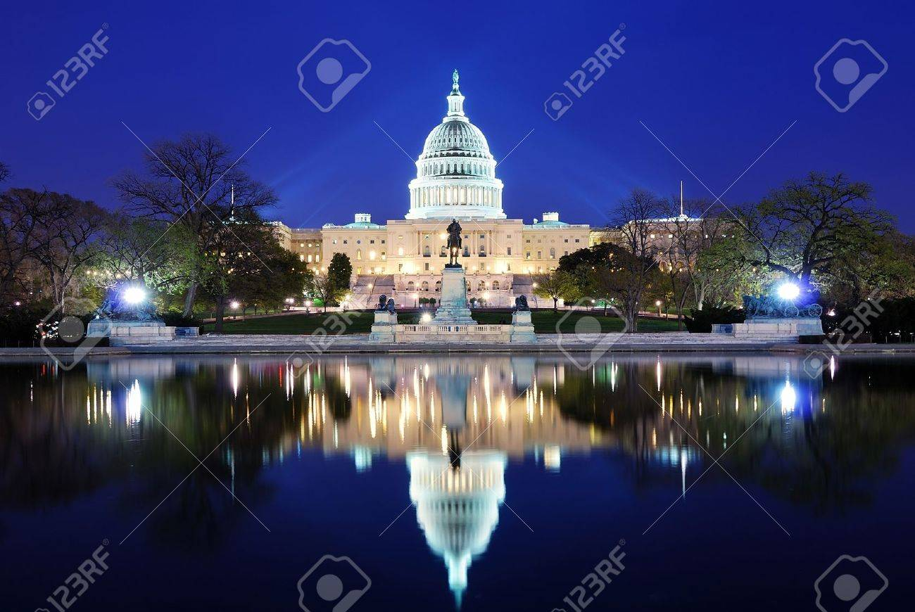 Capitol Hill Building at dusk with lake reflection and blue sky, Washington DC. - 7158991