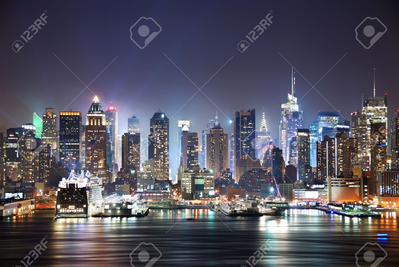 New York City Manhattan skyline panorama at night over Hudson River with refelctions viewed from New Jersey - 7324213