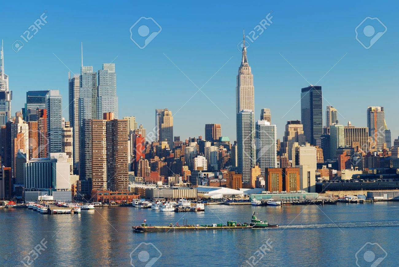 Urban city skyline, Manhattan with Empire State Building, New York City over Hudson River with boat and pier. Stock Photo - 7324252