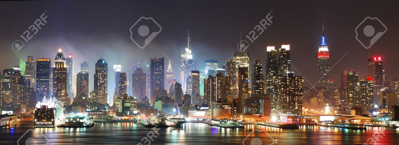 New York City Manhattan skyline panorama at night over Hudson River with refelctions viewed from New Jersey Stock Photo - 7324276