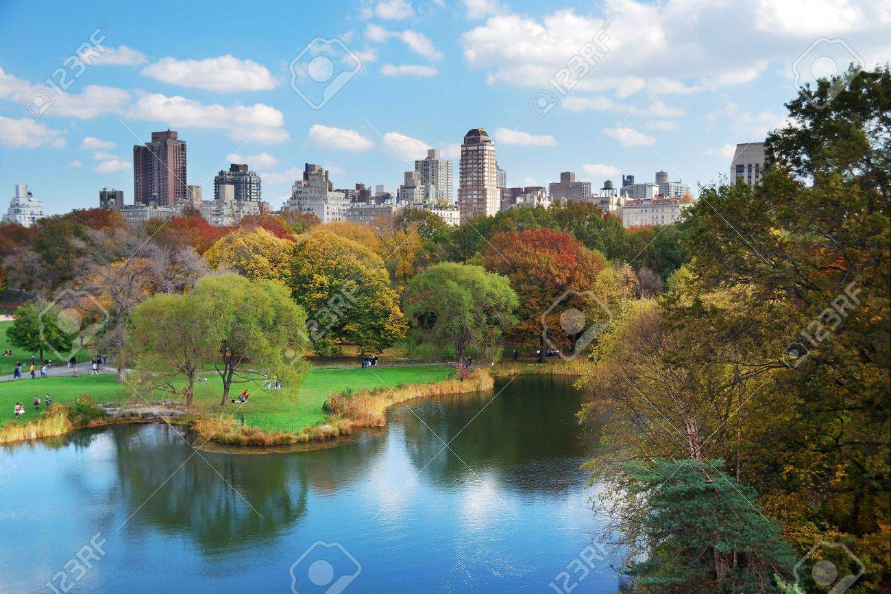 New York City Central Park in Autumn with Manhattan skyscrapers and colorful trees over lake with reflection. Stock Photo - 8339502