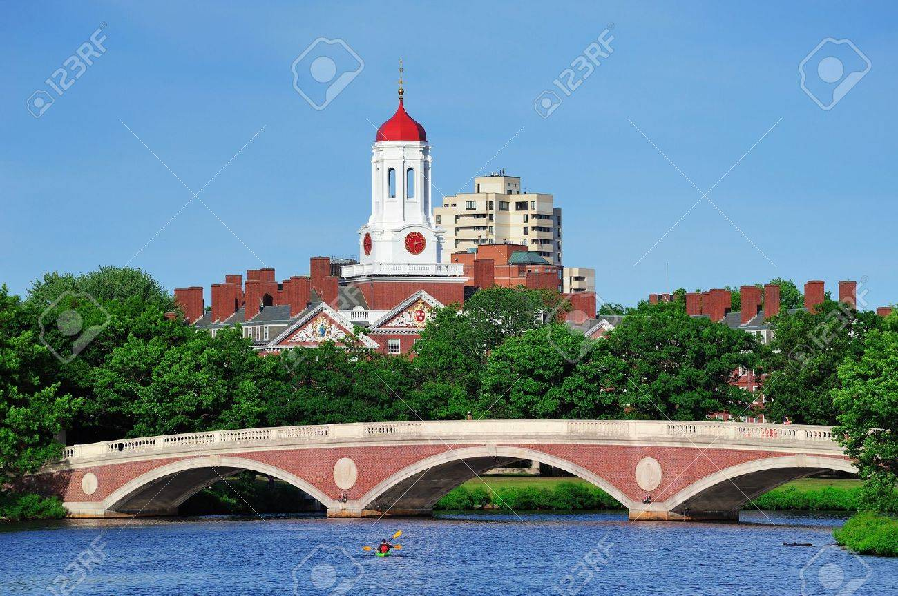 John W. Weeks Bridge and clock tower over Charles River in Harvard University campus in Boston with trees, boat and blue sky. Stock Photo - 10603731