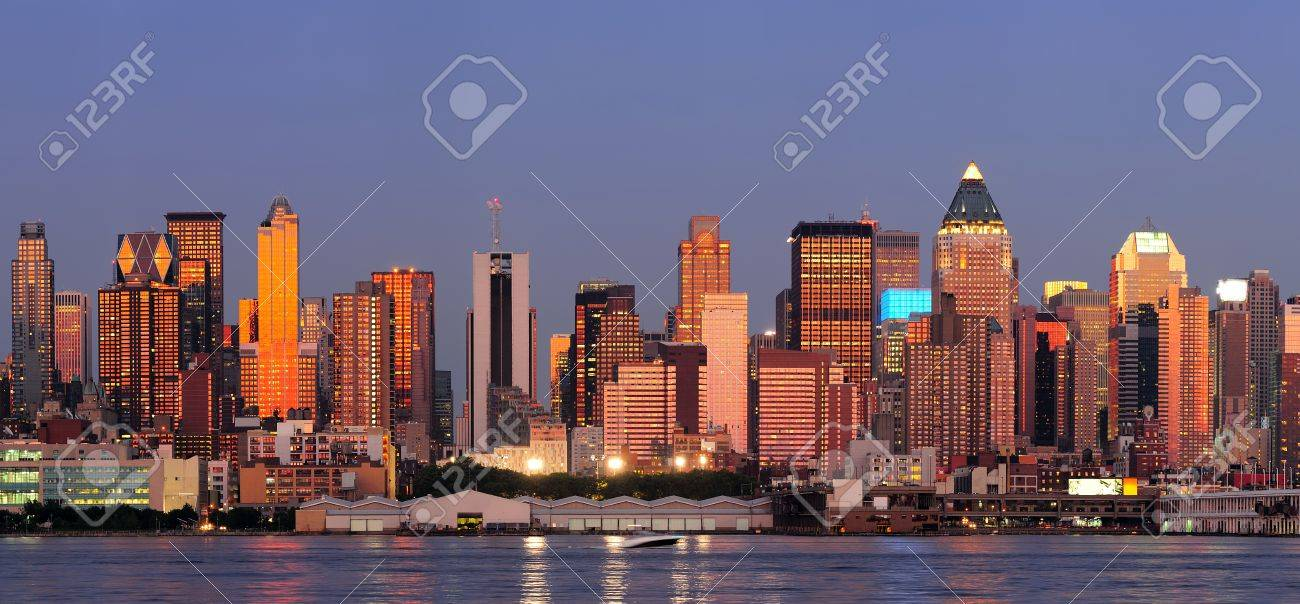New York City Manhattan sunset panorama with historical skyscrapers over Hudson River with beautiful red color sunshine reflection viewed from New Jersey Weehawken waterfront. Stock Photo - 11007060
