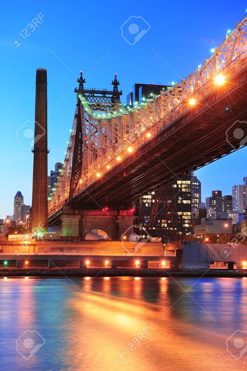Queensboro Bridge over New York City East River at sunset with river reflections and midtown Manhattan skyline illuminated. Stock Photo - 11999569