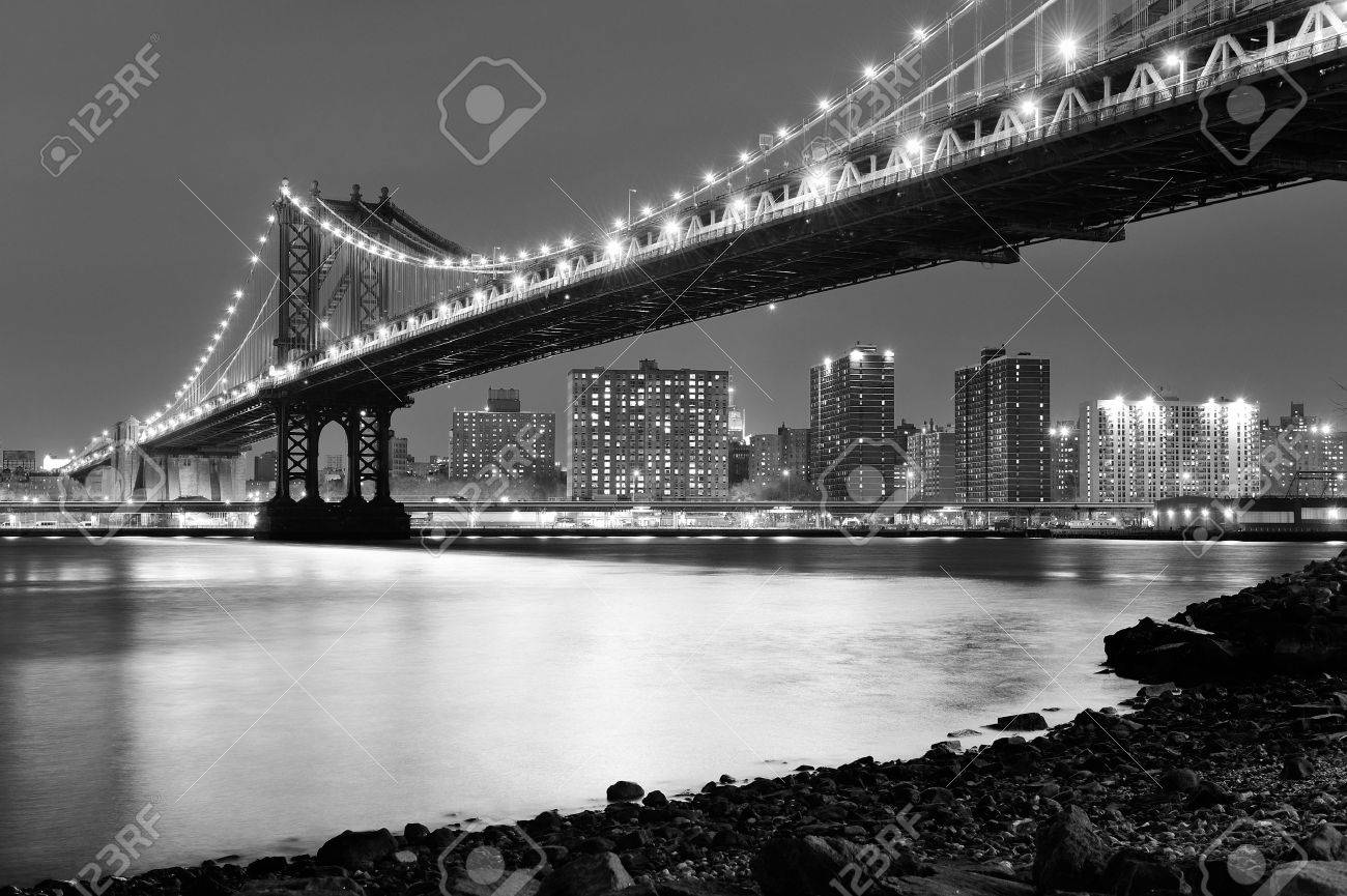 New York City Manhattan Bridge closeup black and white with downtown skyline over East River. Stock Photo - 12571497