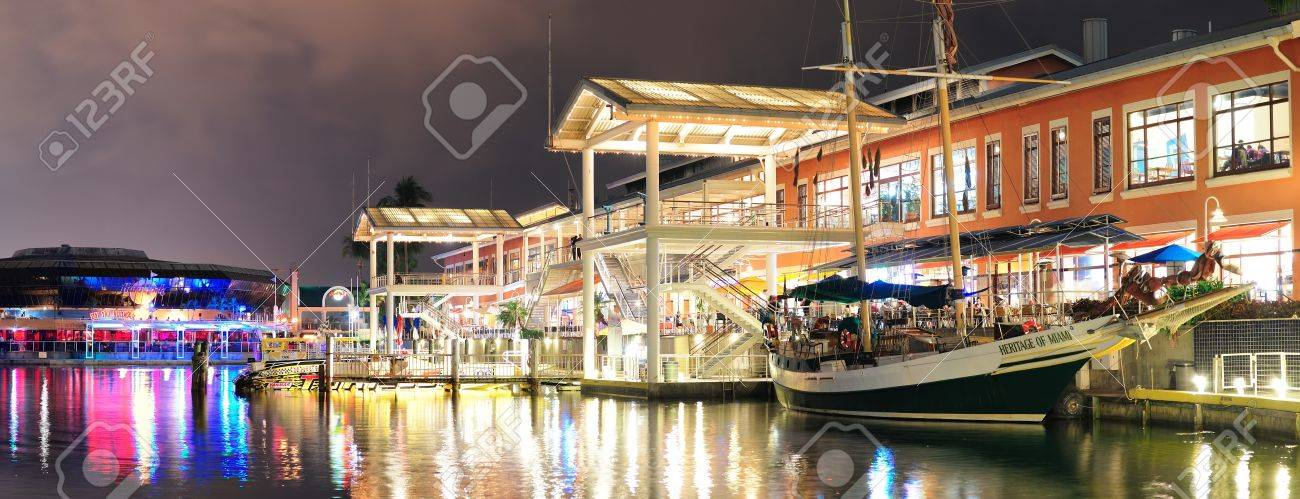 MIAMI, FL - FEB 8: Bayside Marketplace at night on February 8, 2012 in Miami, Florida. It is a festival marketplace and the top entertainment complex in Downtown Miami attracting 15M people annually. Stock Photo - 12559762