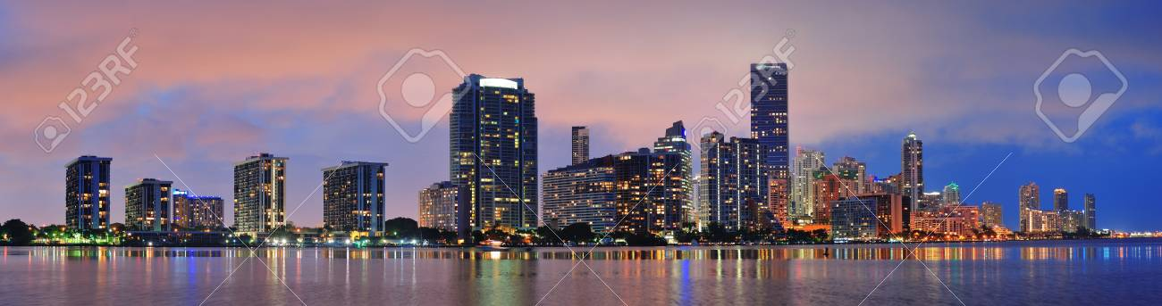 Miami city skyline panorama at dusk with urban skyscrapers over sea with reflection Stock Photo - 12571322