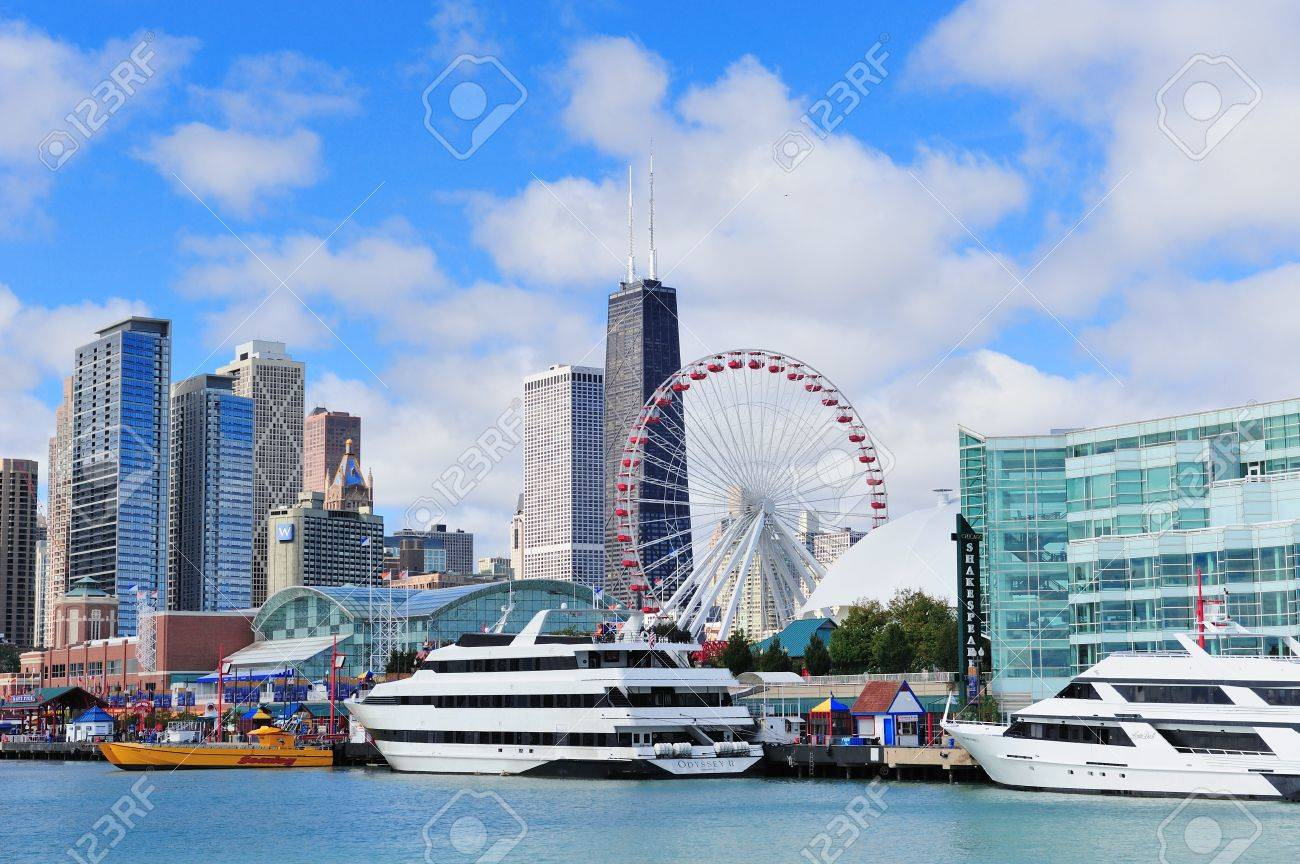 CHICAGO, IL - Oct 1: Navy Pier and skyline on October 1, 2011 in Chicago, Illinois. It was built in 1916 as 3300 foot pier for tour and excursion boats and is Chicago's number one tourist attraction. Stock Photo - 13021465