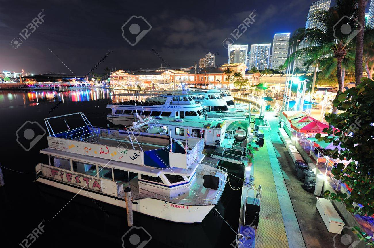 MIAMI, FL - FEB 8: Bayside Marketplace at night on February 8, 2012 in Miami, Florida. It is a festival marketplace and the top entertainment complex in Downtown Miami attracting 15M people annually. Stock Photo - 13021672