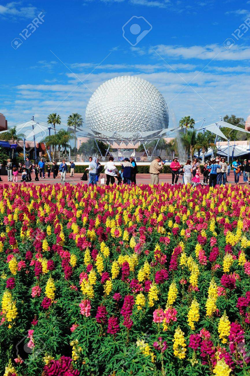 ORLANDO, FL - FEB 13: Disney Epcot Space Ship Earth with flower on February 13, 2012 in Orlando, Florida. Epcot is the third most visited theme park in the US, and fifth in the world. Stock Photo - 13021731