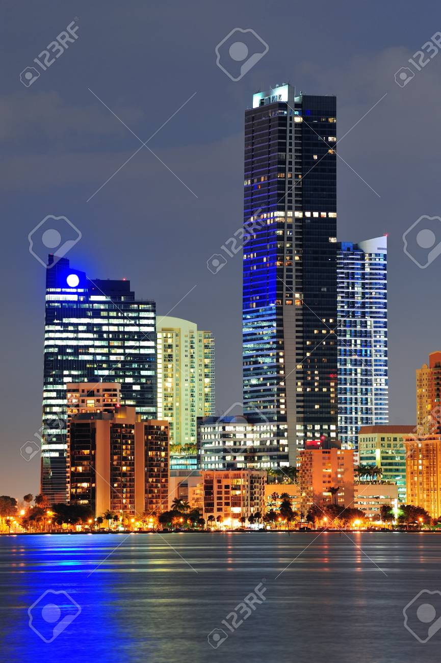 Miami city architecture closeup at dusk with urban skyscrapers over sea with reflection Stock Photo - 12993221