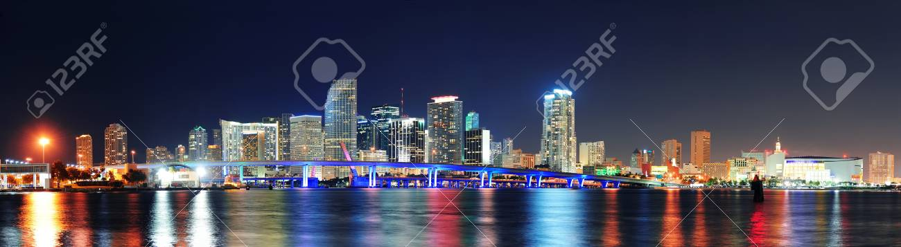 Miami city skyline panorama at dusk with urban skyscrapers and bridge over sea with reflection Stock Photo - 12987700