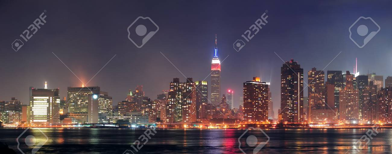 New York City Manhattan midtown panorama at dusk with skyscrapers illuminated over east river Stock Photo - 12993224