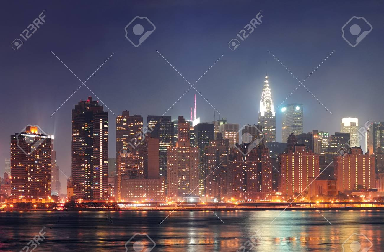 New York City Manhattan midtown panorama at night with skyscrapers illuminated over east river Stock Photo - 14117563