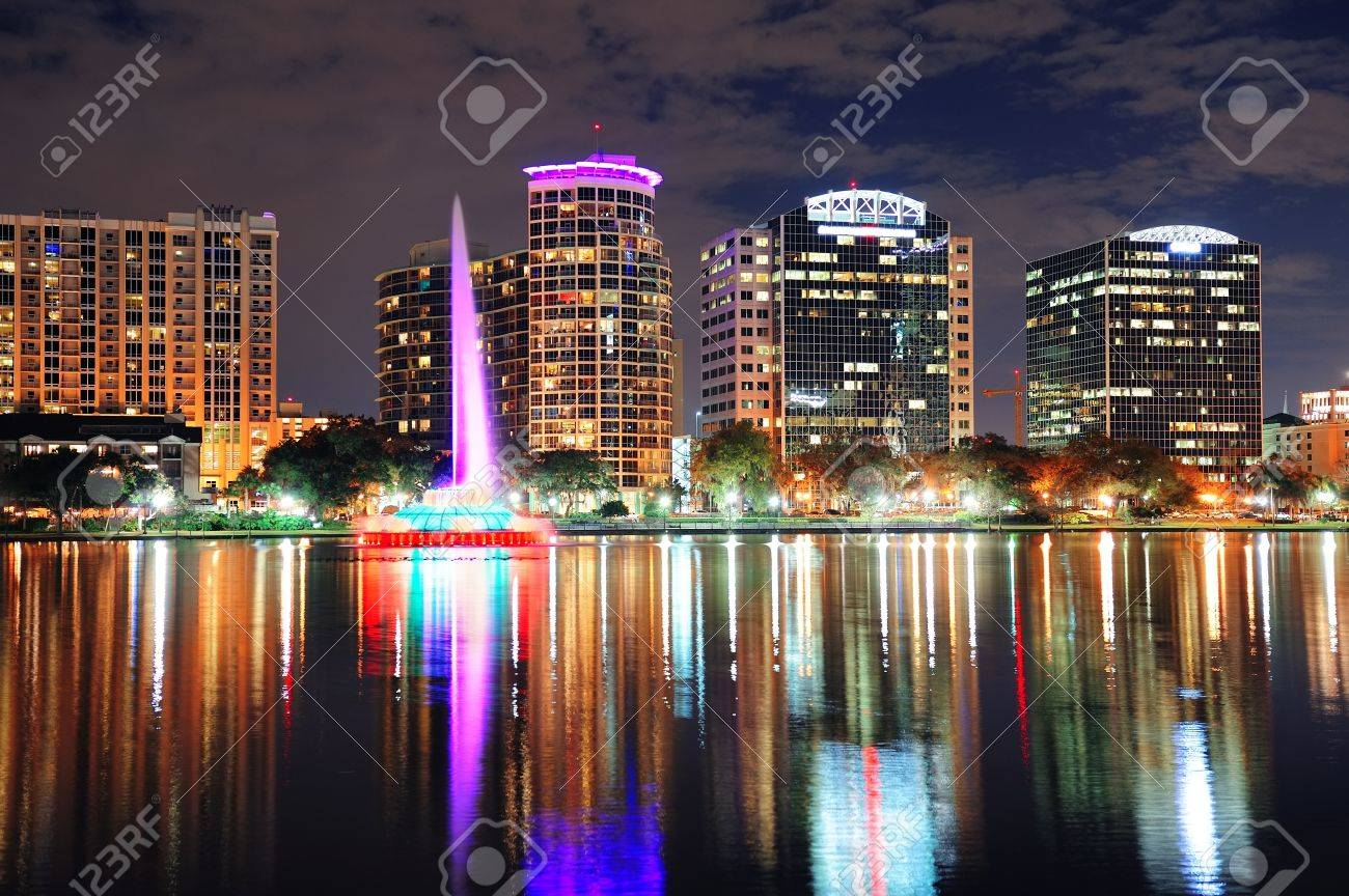 Orlando downtown skyline over Lake Eola at dusk with urban skyscrapers and lights. Stock Photo - 14803803