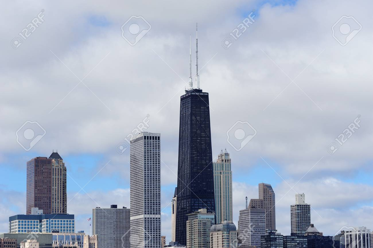 Chicago city urban skyline with skyscrapers over Lake Michigan with cloudy blue sky. Stock Photo - 15653987