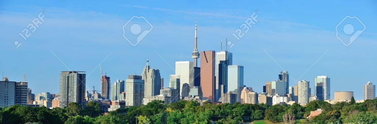 Toronto skyline over park with urban buildings and blue sky Stock Photo - 16385827