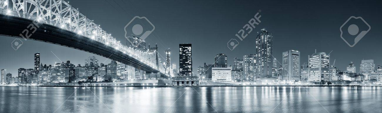 Queensboro Bridge over New York City East River black and white at night with river reflections and midtown Manhattan skyline illuminated Stock Photo - 17454666