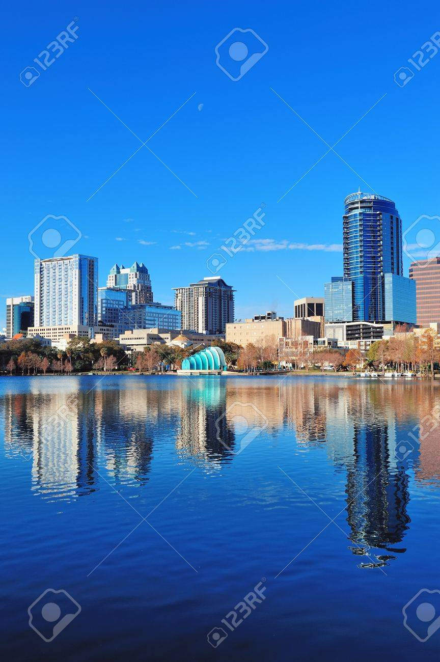 Orlando Lake Eola in the morning with urban skyscrapers and clear blue sky. Stock Photo - 18036524