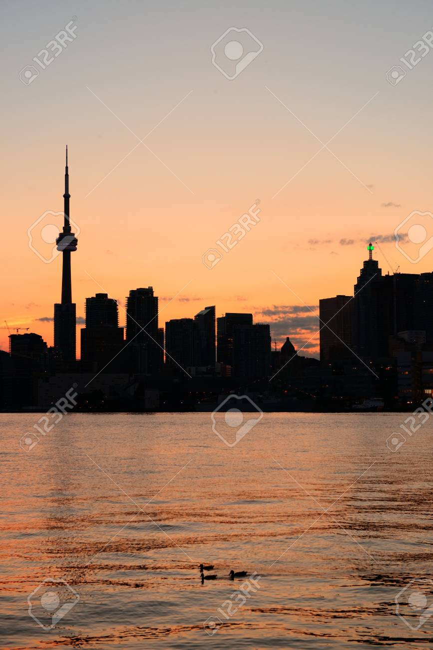 Toronto city skyline silhouette at sunset over lake with urban skyscrapers Stock Photo - 18041926