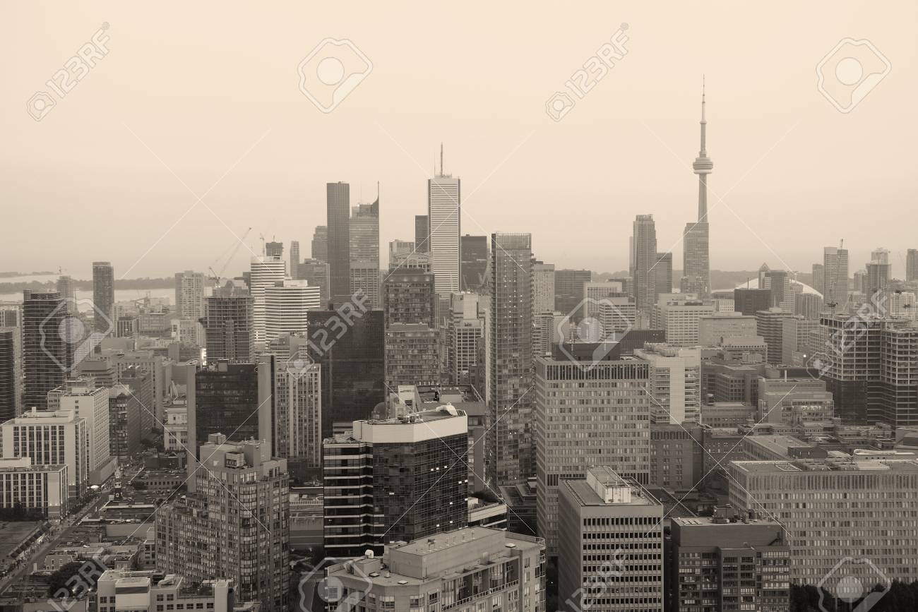 Toronto at dusk with city light and urban skyline with skyscrapers in black and white Stock Photo - 20369399