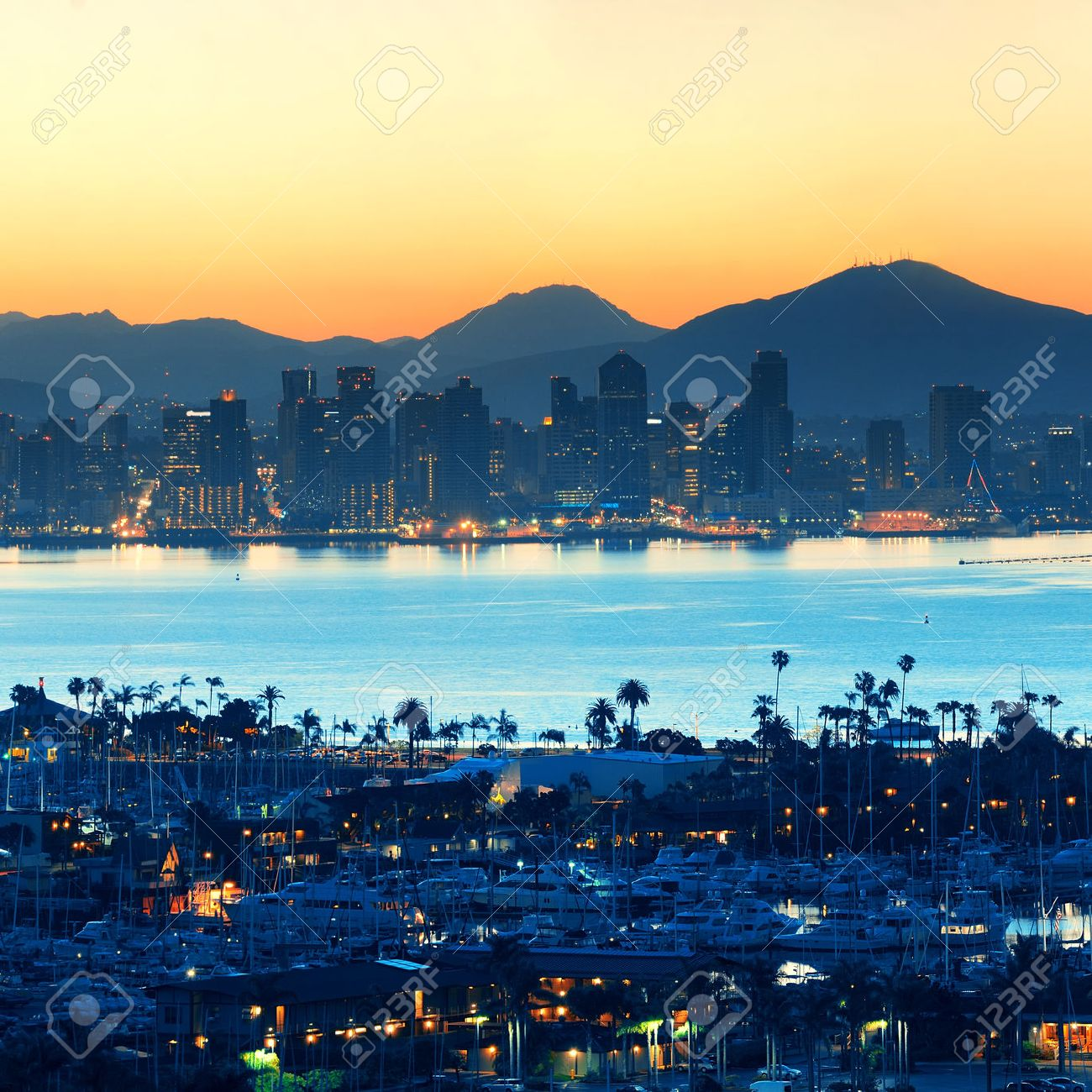 San Diego downtown skyline at sunrise with boat in harbor. - 35720953