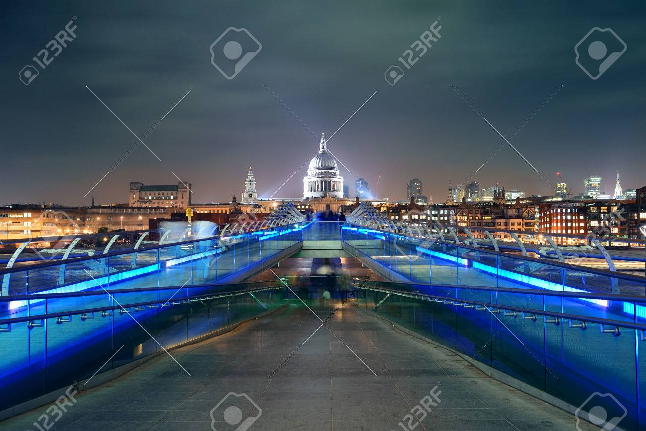Millennium Bridge and St Pauls Cathedral at night in London - 49200597