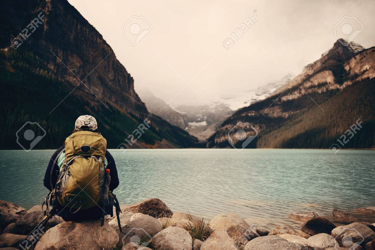 A female hiker at Lake Louise in Banff national park with mountains and forest in Canada. - 53479838