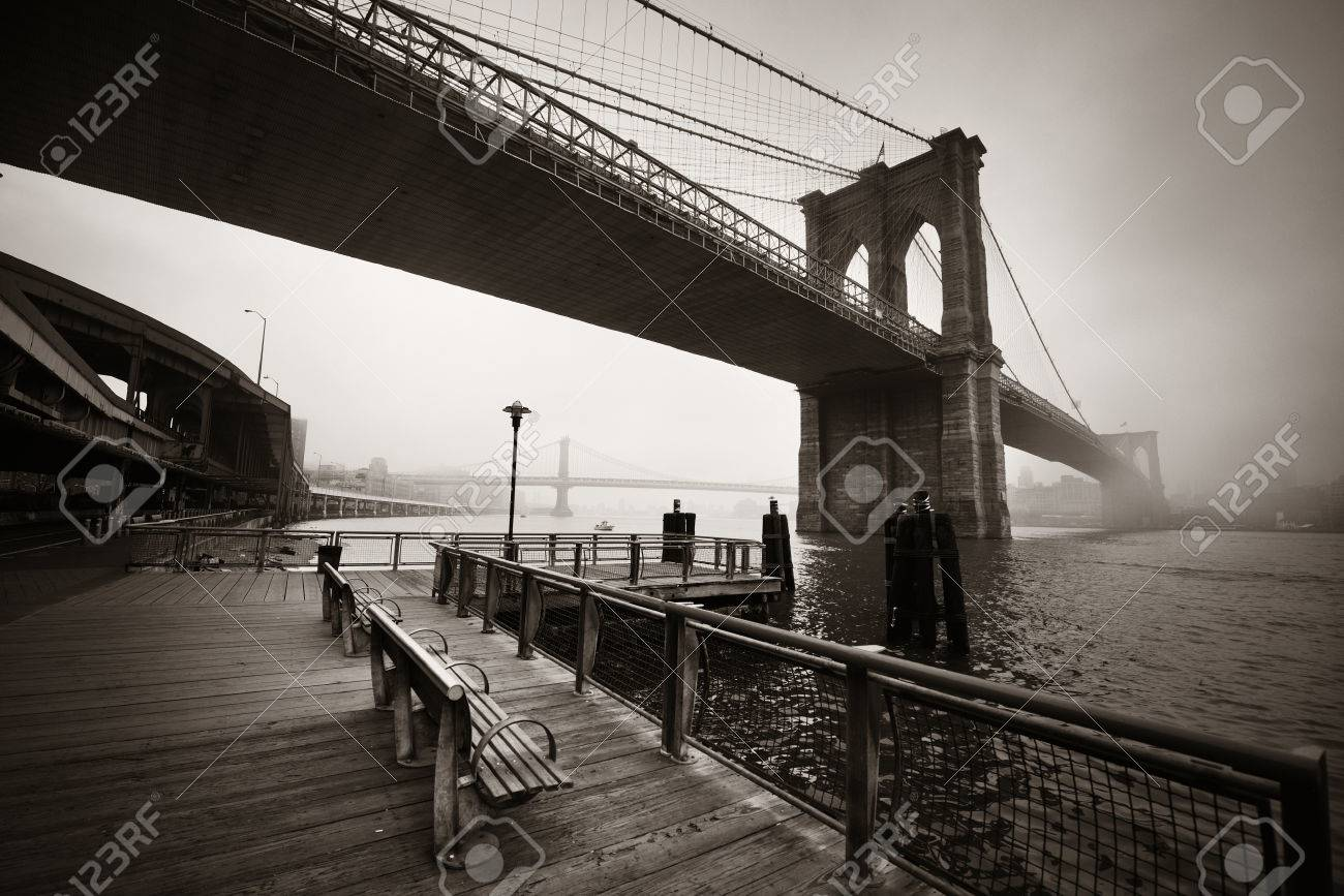 Brooklyn Bridge in a foggy day in downtown Manhattan - 64927219
