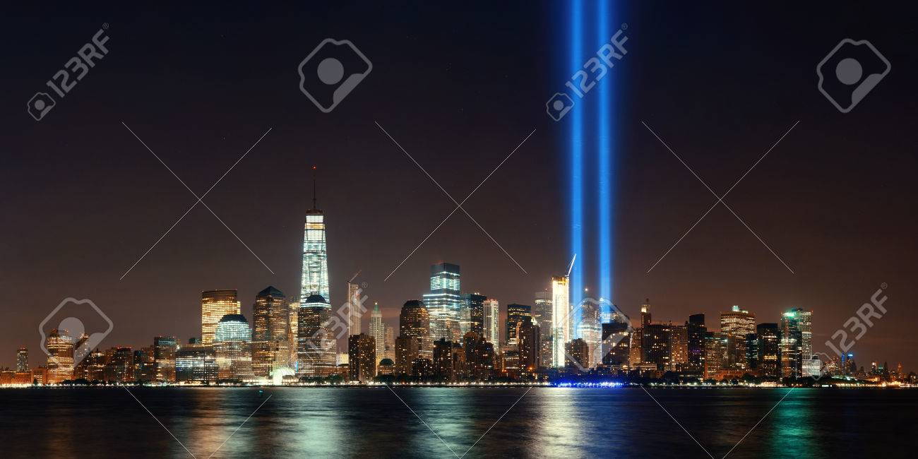 New York City downtown skyline at night panorama over Hudson River and September 11 tribute light - 60906033
