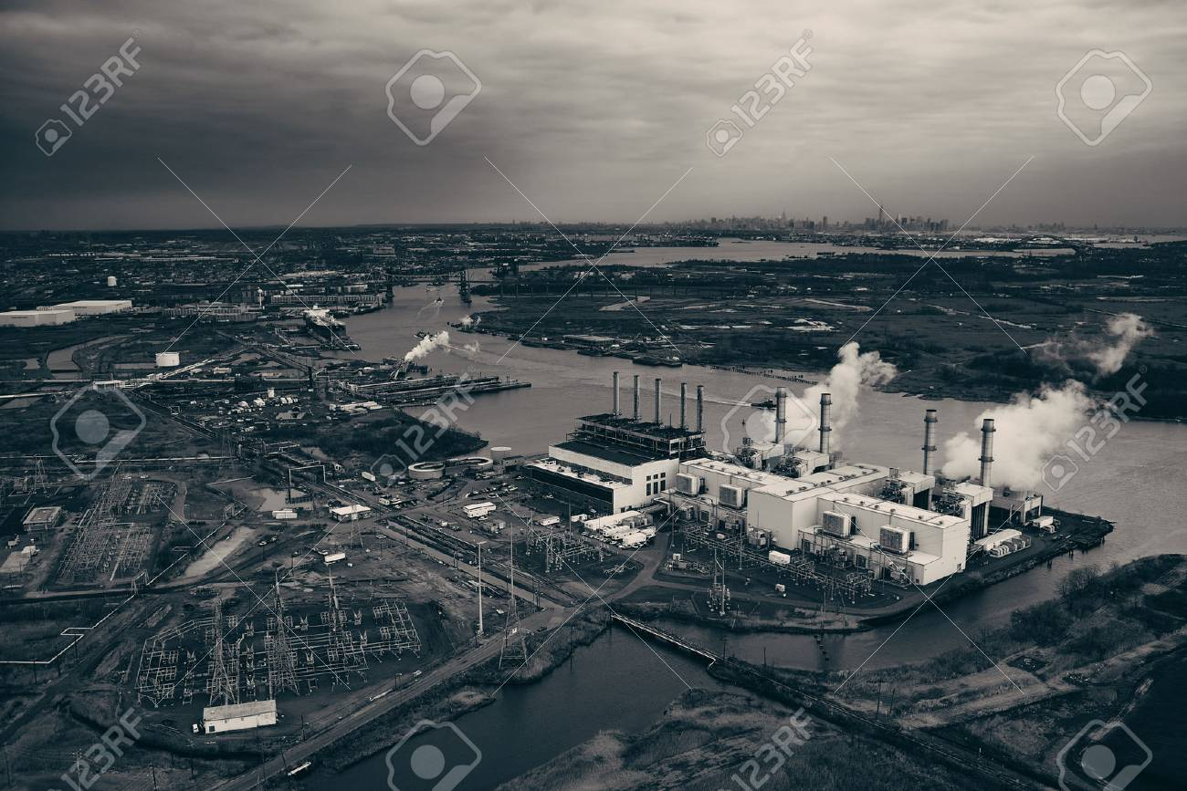 New Jersey oil industry with New York City skyline from afar aerial view - 72061487