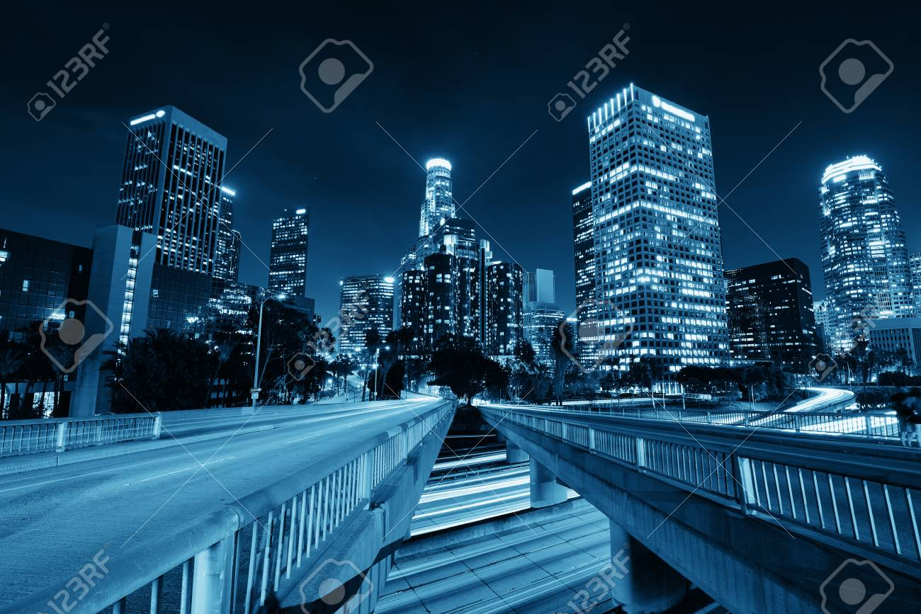 Los Angeles downtown at night with urban buildings and light trail - 90330901