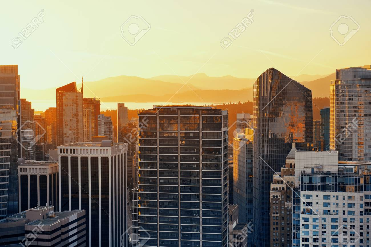 Vancouver rooftop view with urban architectures at sunset. - 100219573