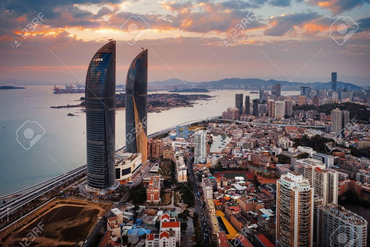 112352528 xiamen china %C3%A2%E2%82%AC%E2%80%9C aerial view of shimao twin tower at sunset in xiamen
